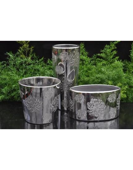 Diverse zilveren potten en vazen